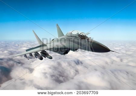 Military Fighter Jet Flies In The Sky Above The Clouds