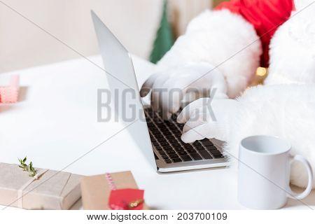 Santa Claus Typing On Laptop