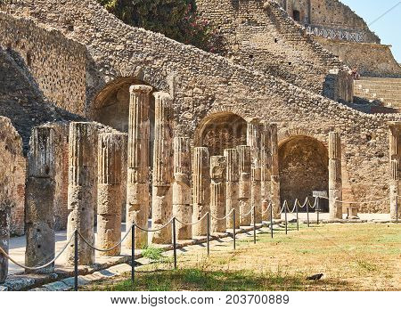 Colonnade of Quadriportico at Ruins of Pompeii. The city was an ancient Roman city destroyed by the volcano Vesuvius. Pompei Campania Italy.