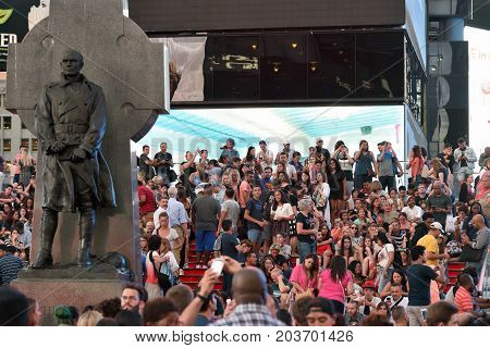 NEW YORK CITY - AUG. 26 : Unidentified people on the Times Square in Manhattan on August 26 2017 in New York City NY. Times Square is a major tourist destination and entertainment center.