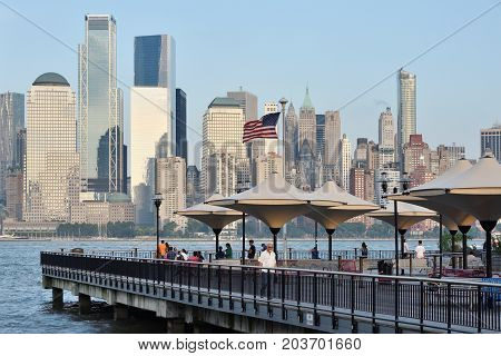JERSEY CITY USA - AUG. 23 : Hudson River pier and Manhattan on August 23 2017 in New York City NY. Manhattan is the most densely populated borough of New York City.