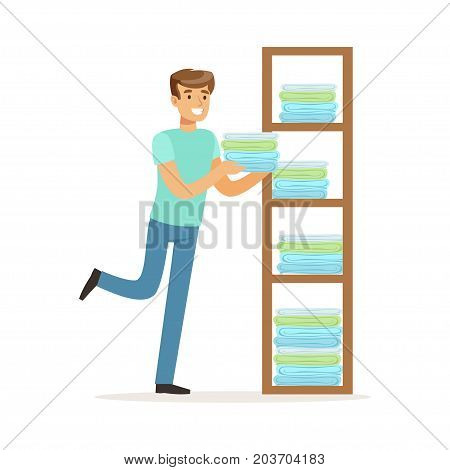 Young smiling man putting linen on shelves, house husband working at home vector Illustration on a white background