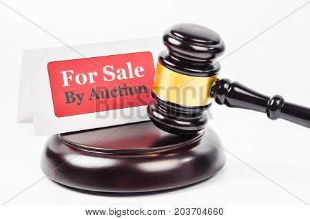 The Auction sales with wooden gavel on white background.