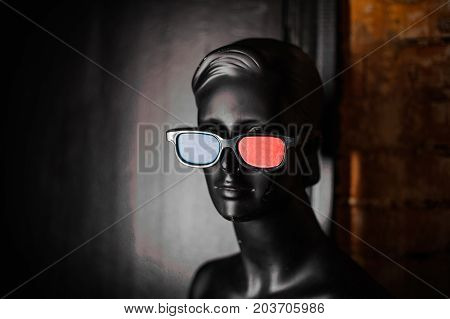 Black mannequin in stereo 3d glasses on a black background