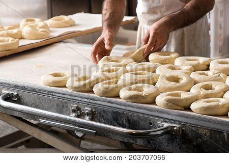 Baker Preparing Dough For Bagels