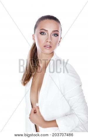 beautiful sexy tanned brunette woman with perfect makeup in white jacket