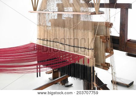 Old Wooden Hand Loom With Red And White Threads