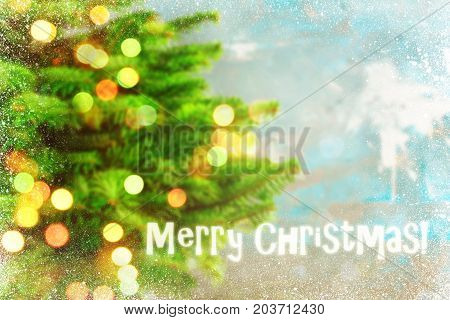 Blured holiday background with Christmas tree and bokeh lights. Copy space
