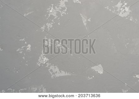 Gray heterogeneous concrete background with traces of spatula.