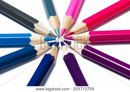 Pencils stacked in a circle. Cold colors. A bright picture on the theme of drawing education school creativity