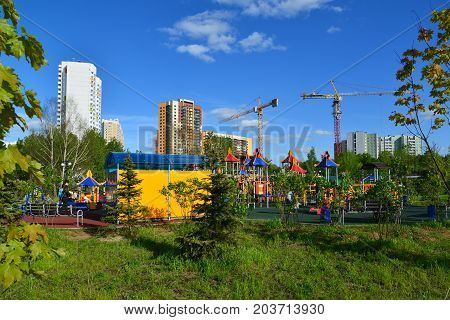 Khimki, Russia - May 30.2017. childrens play complex on the background of under construction in park Eco shore