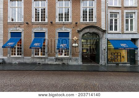 MAASTRICHT NETHERLANDS - JANUARY 09 2015: The narrow shopping streets in the historic center. Maastricht is the oldest city of the Netherlands and the capital city of the province of Limburg.