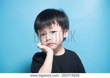Asian boy got dairy or milk allergy got red skin rash around his month keep scratching blue background poster