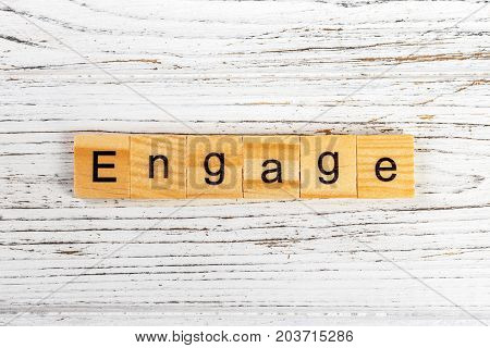 ENGAGE word made with wooden blocks concept