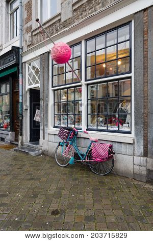 MAASTRICHT NETHERLANDS - JANUARY 09 2015: An unusual bike in front of a shop for the sale of sewing accessories. Maastricht is the oldest city of the Netherlands and the capital city of the province of Limburg.