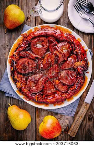 Tarte Tatin With Caramelized Pears, Orange Zest And Almonds