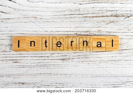 INTERNAL word made with wooden blocks concept