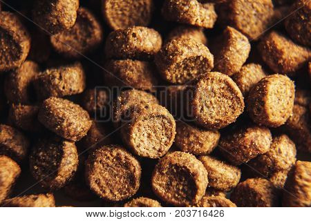 Dried dog and cat food background macro . cat food wallpaper closeup