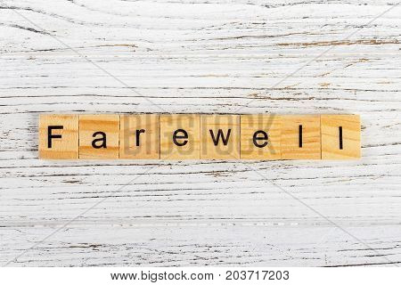 FAREWELL word made with wooden blocks concept