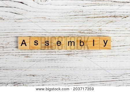 ASSEMBLY word made with wooden blocks concept