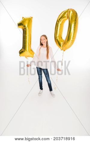 adorable happy female child holding golden balloons with number ten for birthday isolated on white