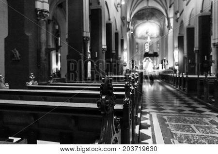 MAASTRICHT NETHERLANDS - JANUARY 09 2015: Interior of Basilica of St. Servatius. Focus on foreground. Black and white. The Basilica of St. Servatius is a oldest Roman catholic church the Netherlands.
