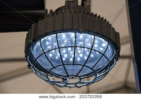 Industrial explosion-proof lantern of black and gray shines with white light at coal mining exhibition