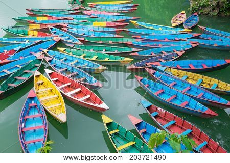 Traditional Nepalese Boats At The Docks At Fewa Lake, Pokhara City, Nepal