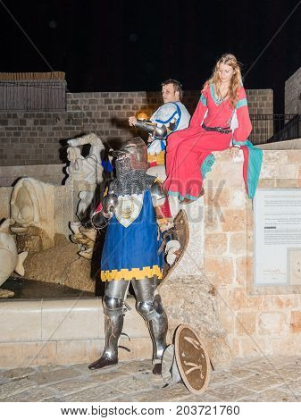 Tel Aviv-Yafo Israel September 08 2017: Members of the Knights of Jerusalem club - two knights and a lady dressed in traditional armor and costumes posing for photographers at night in the old town of Yafo in Tel Aviv-Yafo Israel