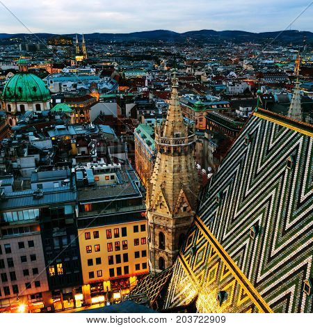 Vienna Austria. Aerial view of the night Vienna Austria with illuminated buildings and Stephansdom cathedral