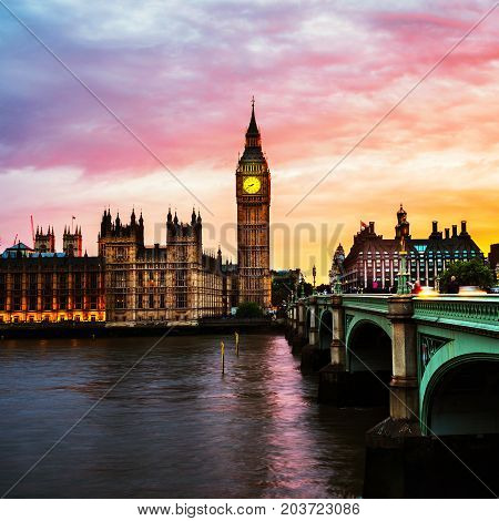 London UK. Sunset over the city of London UK. Colorful sky behind Westminster and Big Ben. Westminster bridge at night