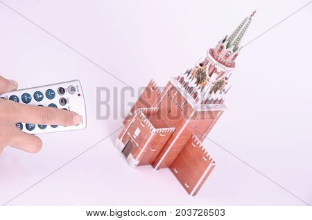 SARANSK, RUSSIA - SEPTEMBER 05, 2017: The remote control is aimed at the 3D puzzle of the Spasskaya Tower.
