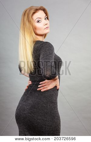 Attractive Blonde Woman Wearing Tight Black Dress