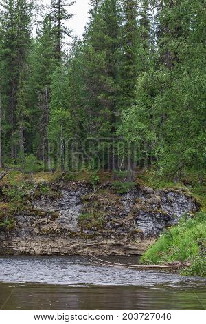 Сrag near the river. Taiga. The rivers of the north of Siberia. Russia