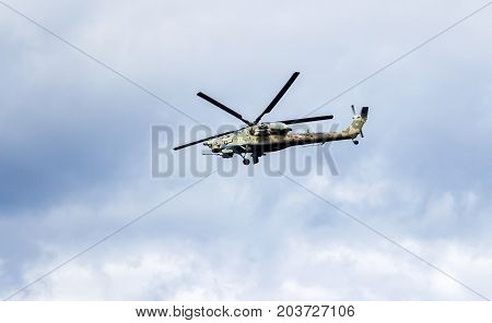 Samara Russia - September 10 2017: Russian Air Force Mi-28 Havoc military attack combat helicopter in camouflage flying against cloudy sky