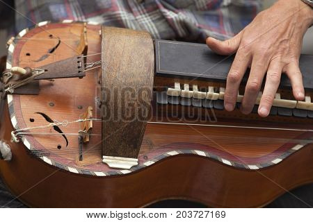 Playing an old violin instrument in French Britain
