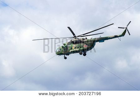 Samara Russia - September 10 2017: Russian Air Force Mi-8 helicopter in camouflage flying against cloudy sky