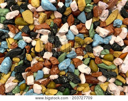close up on many colorful candy rocks. Flat lay top view background.