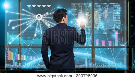 Back side of Businessman drawing the Technical information over the virtual screen on the Part of earth network line background out off windowElements of this image furnished by NASABusiness concept, 3D illustration