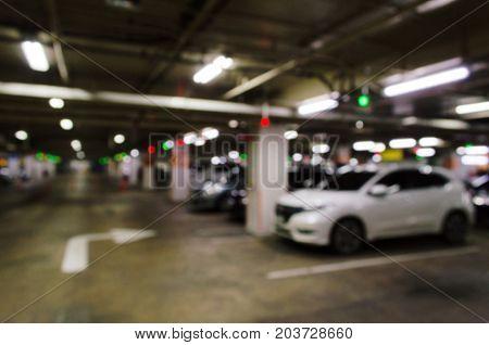 abstract blurred image of under ground indoor car parking garage area RFID solution management system car park system technology concept vintage filter color tone effect