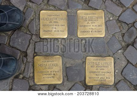 BERLIN - FEBRUARY 22 2015: Stolperstein on the famous street Kurfuerstendamm. A stolperstein is a monument created by Gunter Demnig which commemorates a victim of the Holocaust.