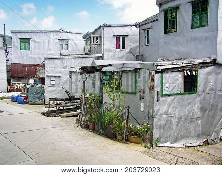 Small silver-painted houses in the fishing village Tai O on the island of Lantau, Hong Kong