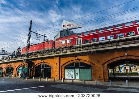 BERLIN - MARCH 08 2015: City life. Railroad overpass near the Zoologischer Garten and Neues Kranzler Eck. Toning. Stylization.