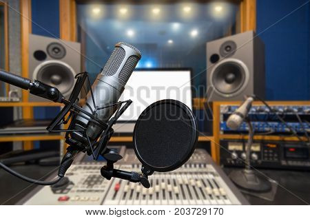 Professional condenser studio microphone over the abstract photo blurred of music studio background Musical instrument Concept, 3D illustration