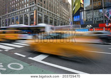 NEW YORK CITY USA - AUG. 25 : Yellow taxis on street in Manhattan on August 25 2017 in New York City NY. Manhattan is the most densely populated borough of New York City.
