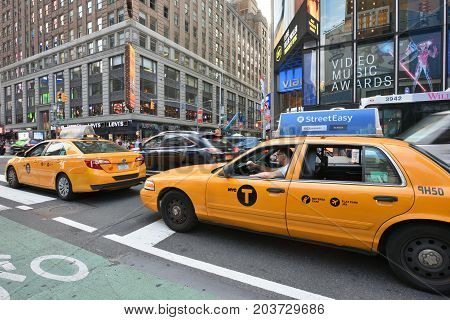 NEW YORK CITY USA - AUG. 26 : Yellow taxis on street in Manhattan on August 26 2017 in New York City NY. Manhattan is the most densely populated borough of New York City.