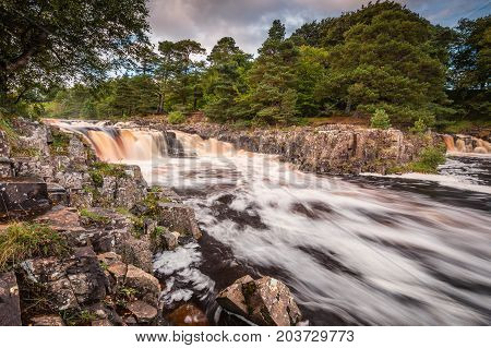 Low Force and Whin Sill, as the River Tees cascades over the Whin Sill at Low Force Waterfall and the Pennine Way follows the southern riverbank