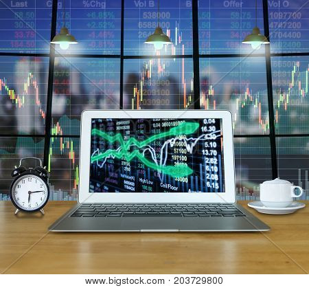 Workspace with computer laptop on the wood table which shown stock market exchange on the screen with trading graph over the cityscape building background business trading technology concept, 3D illustration
