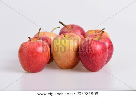 Apples In Bright And Juicy Red Colors On Grey Background