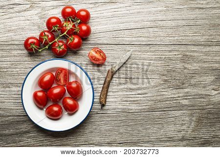 Fresh tomatoes on wooden background. Top view
